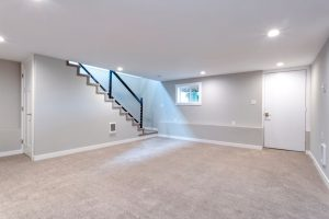 light spacious basement area with staircase